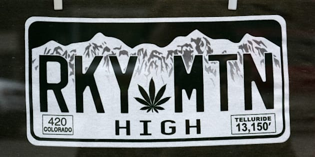 TELLURIDE, CO - JULY 7, 2014: A T-shirt in a souvenir shop window display in Telluride, Colorado, make a reference to the state's legal sale and use of recreational marijuana. (Photo by Robert Alexander/Getty Images)