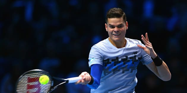 LONDON, ENGLAND - NOVEMBER 11:  Milos Raonic of Canada plays a forehand in the round robin singles match against Andy Murray of Great Britain on day three of the Barclays ATP World Tour Finals at the O2 Arena on November 11, 2014 in London, England  (Photo by Clive Brunskill/Getty Images)