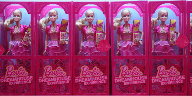BERLIN, GERMANY - MAY 16:  Barbie dolls and other souvenirs line shelves at the merchandising shop at the Barbie Dreamhouse Experience on May 16, 2013 in Berlin, Germany. The Barbie Dreamhouse is a life-sized house full of Barbie fashion, furniture and accessories and will be open to the public until August 25 before it moves on to other cities in Europe.  (Photo by Sean Gallup/Getty Images)