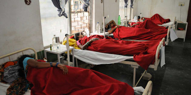 """Indian women who underwent sterilization surgeries receive treatment at the District Hospital in Bilaspur, in the central Indian state of Chhattisgarh, Wednesday, Nov. 12, 2014, after at least a dozen died and many others fell ill following similar surgery. The surgeon who performed the operations at the government-run """"health camp"""" plowed through more than 80 tubectomies in six hours, a clear breach of government protocol, which prohibits surgeons from performing more than 30 sterilizations in a day, said Dr. S.K. Mandal, the chief medical officer in Chhattisgarh Wednesday. The surgeon, Dr. R.K. Gupta, was honored by the state government in January for performing over 50,000 laproscopic tubectomies, Mandal said, adding he believed Gupta was been under pressure to meet government-set targets for sterilizations. Mandal said that his state had a target of 220,000 sterilizations this year and Bilaspur, the district where the botched surgeries took place, had a target of about 15,000 surgeries. (AP Photo)"""