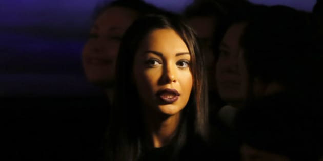 Model and reality TV personality Nabilla attends the presentation of Jean-Paul Gaultier's ready-to-wear Spring/Summer 2014 fashion collection, presented Saturday, Sept. 28, 2013 in Paris. (AP Photo/Jacques Brinon)