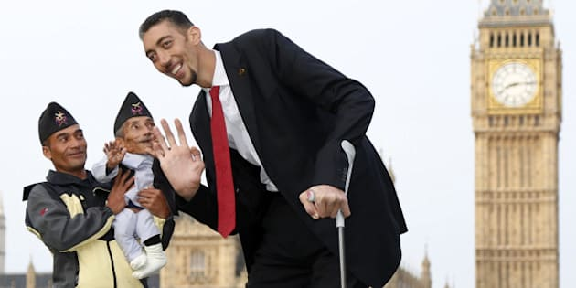 LONDON, ENGLAND - NOVEMBER 13: The worlds tallest man Sultan Kosen meets with the shortest man ever, Chandra Bahadur Dangi for the very first time on November 13, 2014 in London, England. Chandra from Nepal measuring 54.6 cm (21.5 inches) posed for photographers with Sultan from Turkey who is 251 cm (8 ft 3 inches). Today is the 10th annual Guinness World Records Day during which thousands of people are expected to come together to celebrate the international day of record-breaking. (Photo by Yunus Kaymaz/Anadolu Agency/Getty Images)