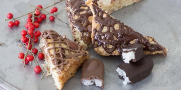 This Sept. 22, 2014 photo shows macaroon bars in Concord, N.H. When it comes to holiday cookies, everything depends on the recipe and a few simple techniques.  (AP Photo/Matthew Mead)