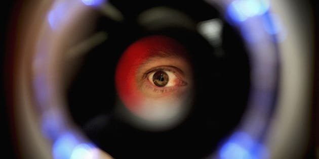LONDON - OCTOBER 14:  A man uses an iris recognition scanner during the Biometrics 2004 exhibition and conference October 14, 2004 in London. The conference will examine the role of new technology such as facial recognition and retinal scans to determine identity to improve security.  (Photo by Ian Waldie/Getty Images)   *** Local Caption ***
