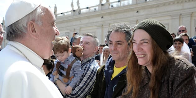 US artist Patti Smith, right, is greeted by Pope Francis at the end of his weekly general audience, in St. Peter's Square at the Vatican, Wednesday, April 10, 2013. (AP Photo/L'Osservatore Romano)