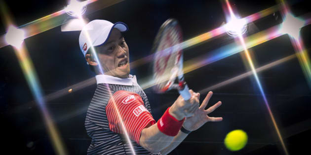 LONDON, ENGLAND - NOVEMBER 13:   (EDITORS NOTE: This image was created using an in camera multiple exposure with a star filter on the lens) Kei Nishikori of Japan plays a forehand in the round robin singles match against David Ferrer of Spain on day five of the Barclays ATP World Tour Finals at O2 Arena on November 13, 2014 in London, England.  (Photo by Justin Setterfield/Getty Images)