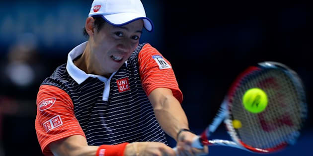 Japan's Kei Nishikori returns to Spain's David Ferrer during their Group B singles match on day five of the ATP World Tour Finals tennis tournament in London on November 13, 2014. AFP PHOTO/GLYN KIRK        (Photo credit should read GLYN KIRK/AFP/Getty Images)