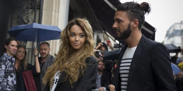 Nabilla Benattia, left, and Thomas Vergara, arrive to attend the Jean-Paul Gaultier Fall Winter 2014-15 Haute Couture fashion collection, presented in Paris, Wednesday, July 9, 2014. (AP Photo/Zacharie Scheurer)
