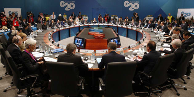 Leaders meet at the first plenary session at the G20 summit in Brisbane, Australia Saturday, Nov. 15, 2014. As G-20 summit host Brisbane sweltered through a blistering heat wave, world leaders on Saturday got down to the business of cementing plans to drag a sagging global economy out of the doldrums. (AP Photo/Kevin Lamarque, Pool)