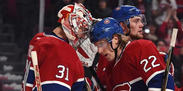 MONTREAL, QC - NOVEMBER 13: Dale Weise #22 of the Montreal Canadiens celebrates the victory with Carey Price #31 against the Boston Bruins in the NHL game at the Bell Centre on November 13, 2014 in Montreal, Quebec, Canada. (Photo by Francois Lacasse/NHLI via Getty Images)