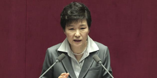South Korean President Park Geun-hye delivers a speech on the government budget at the National Assembly in Seoul, South Korea, Wednesday, Oct. 29, 2014. Park asked lawmakers for cooperation to pass bills of her government's spending plan for 2015. (AP Photo/Ahn Young-joon)