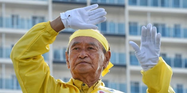 Incumbent governor Hirokazu Nakaima waves to people during his stumping tour for the Okinawa gubernatorial election in Naha on November 15, 2014.  Voters in Japan's far southern Okinawa are braced for the gubernatorial election on November 16, with polls showing an anti-US base candidate Onaga having a lead, an obstacle for Prime Minister Shinzo Abe's efforts to boost alliance with Washington.       AFP PHOTO / Toru YAMANAKA        (Photo credit should read TORU YAMANAKA/AFP/Getty Images)