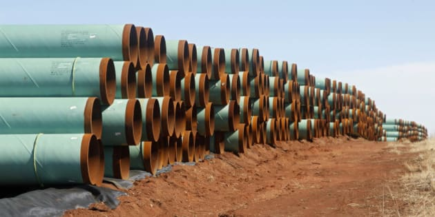 FILE - In this Feb. 1, 2012 file photo, miles of pipe ready to become part of the Keystone Pipeline are stacked in a field near Cushing, Okla. Oklahoma leaders are praising the renewed momentum in Congress to approve the northern leg of the Keystone XL pipeline, although the project will have only a minimal economic impact on the Sooner State.(AP Photo/Sue Ogrocki, File)