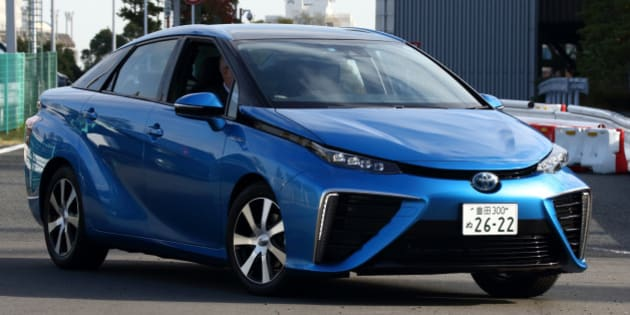 A Toyota Motor Corp. Mirai fuel-cell powered vehicle is driven during a test drive in Tokyo, Japan, on Monday, Nov. 17, 2014. Toyota will start selling its Mirai fuel-cell vehicle next month for 7.24 million yen ($63,000), which Japan will subsidize with the aim of repeating the success of the world's most popular hybrid. Photographer: Tomohiro Ohsumi/Bloomberg via Getty Images