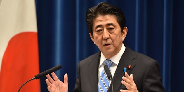 Japan's Prime Minister Shinzo Abe speaks during a press conference at his official residence in Tokyo on November 18, 2014. Abe said November 18 he was delaying an expected sales tax rise and dissolving the lower house of parliament after figures showed Japan was in a recession.    AFP PHOTO / KAZUHIRO NOGI        (Photo credit should read KAZUHIRO NOGI/AFP/Getty Images)