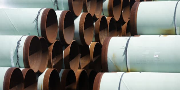 Some of more than 350 miles of pipe awaiting shipment for the Keystone XL oil pipeline is stored at Welspun Tubular, in Little Rock, Ark., Wednesday, Aug. 20, 2014. (AP Photo/Danny Johnston)