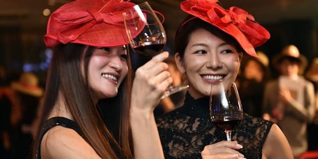 Japanese wine drinkers toast the 2014 vintage Beaujolais Nouveau wine at an event in Tokyo on November 20, 2014, after an embargo on the wine was removed at midnight. A total of seven million bottles of Beaujolais Nouveau wine are expected to be imported to Japan this year. AFP PHOTO/Yoshikazu TSUNO        (Photo credit should read YOSHIKAZU TSUNO/AFP/Getty Images)