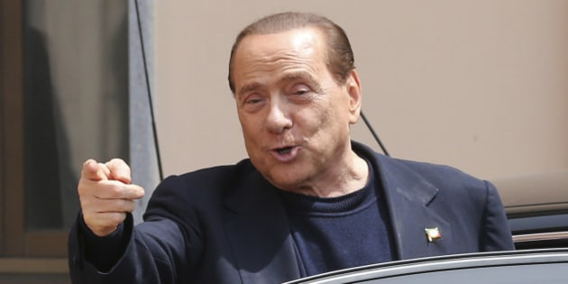 "Former Italian Premier Silvio Berlusconi smiles as he leaves the ""Sacra Famiglia"" foundation in Cesano Boscone, near Milan, Italy, Friday, May 9, 2014. Berlusconi, 77, was ordered to perform four hours of community service a week for a year after his four-year sentence was reduced to one by a general amnesty. He also lost his Senate seat due to the conviction, but remains an important political force as head of his Forza Italia party. The court's order permits him flexibility to campaign for the upcoming European elections, but only in the northern Lombard region and around Rome, where he can travel from Tuesday to Thursday. (AP Photo/Antonio Calanni)"