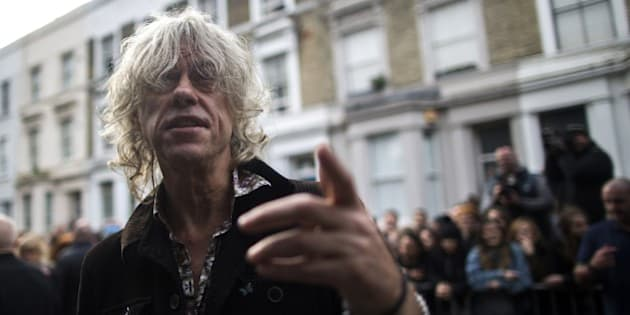 Irish musician Bob Geldof arrives at a west London studio to record the new Band Aid 30 single on November 15, 2014. Bob Geldof, One Direction, Bono and some 30 other stars gathered in a studio in London on Saturday to record a 30th anniversary version of the Band Aid charity single to raise money to fight Ebola. Led Zeppelin's Robert Plant, Coldplay's Chris Martin and Sinead O'Connor were also among the rockers brought together by Geldof to sing the fourth version of 'Do They Know It's Christmas?' Musicians began arriving in the early morning and were expected to record all day and into the night before the single is aired for the first time on Sunday and then officially released on Monday. AFP PHOTO / ANDREW COWIE        (Photo credit should read ANDREW COWIE/AFP/Getty Images)