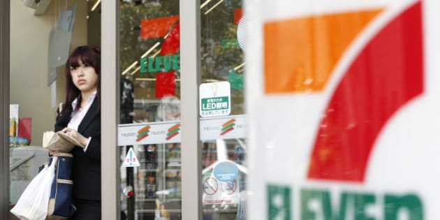 A woman exits a 7-Eleven convenience store, operated by Seven & I Holdings Co., in Tokyo, Japan, on Thursday, April 4, 2013. Seven & I Holdings Co., owner of the 7-Eleven convenience-store brand, forecast a 23 percent increase in profit this fiscal year after the addition of new stores. Photographer: Kiyoshi Ota/Bloomberg via Getty Images