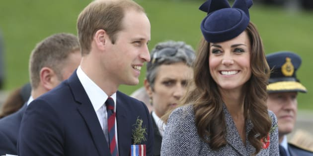 Britain's Prince William and his wife Kate, the Duchess of Cambridge, chat during the Anzac Day parade at the Australian War Memorial in  Canberra,  Australia, Friday, April 25, 2014. The Duke and Duchess attended the memorial as the last engagement of their three week state visit of New Zealand and Australia with their son Prince George.(AP Photo/Rob Griffith)