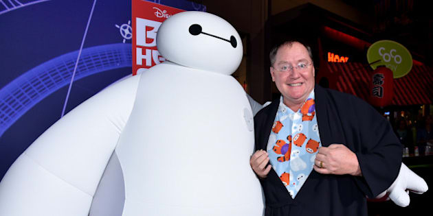 """HOLLYWOOD, CA - NOVEMBER 04:  Chief Creative Officer at Pixar, Walt Disney Animation Studios and DisneyToon Studios John Lasseter (R) with character Baymax attends the Los Angeles Premiere of Walt Disney Animation Studios' """"Big Hero 6' at El Capitan Theatre on November 4, 2014 in Hollywood, California.  (Photo by Alberto E. Rodriguez/Getty Images for Disney)"""