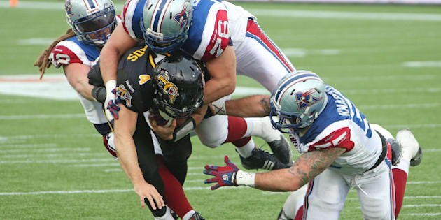 HAMILTON, ON - NOVEMBER 23:  Zach Collaros #4 of the Hamilton Tiger-Cats is brought down short of the goal line against the Montreal Alouettes during the CFL football Eastern Conference Final at Tim Hortons Field on November 23, 2014 in Hamilton, Ontario, Canada. The Tiger-Cats defeated the Alouettes 40-24. (Photo by Claus Andersen/Getty Images)
