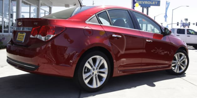 In this Aug. 30, 2011 photo a 2011 Chevrolet Cruze is displayed at a car dealership in San Jose, Calif. General Motors' car and truck sales rose 18 percent last month as fuel-efficient vehicles helped offset a roiling stock market and Hurricane Irene. (AP Photo/Paul Sakuma)