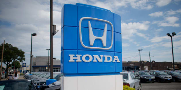 Honda Motor Co. signage is displayed at the Paragon Honda dealership in the Queens borough of New York, U.S., on Monday, Sept. 1, 2014. Domestic and total vehicle sales figures are scheduled to be released on Sept. 3. Photographer: Craig Warga/Bloomberg via Getty Images