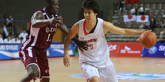Qatar's Erfan Ali Saeed (L) guards against Japan's Joji Takeuchi (R) in their men's basketball preliminary round match during the 17th Asian Games at the Hwaseong Sports Complex Gymnasium in Incheon on September 25, 2014.    QATAR OUT    AFP PHOTO / AL-WATAN DOHA / KARIM JAAFAR        (Photo credit should read KARIM JAAFAR/AFP/Getty Images)