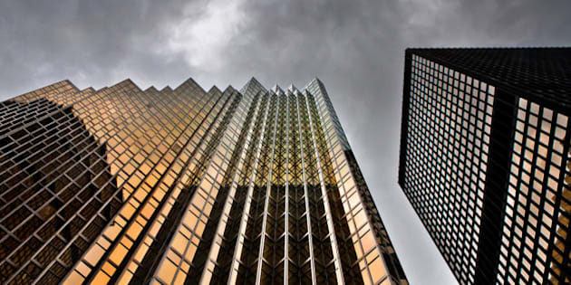 """The RBP North Tower at No 200 Bay St is in the heart of the Toronto Canada financial district. Built in 1976, the skyscraper has 14000 windows that were manufactured using 2500 ounces of 24 carat gold baked into the glass. The gold helps to insulate the building.  According to police records, no one has ever stolen any of the windows.  Canon EOS 60D body with a Sigma 17-70mm f2.8 DC Macro OS lens.   Shameless Self Promotion: <a href=""""http://thelearningcurve.ca/"""" target=""""_blank"""" rel=""""nofollow"""">Website</a>