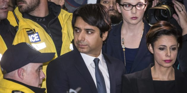 TORONTO, ON - NOVEMBER 26:  Jian Ghomeshi leaving College Park Court with his Lawyer Marie Henein after Ghomeshi was released on $100,000 bail.  The 47-year-old has been charged with four counts of sexual assault and one count of overcome resistance (choking).        (David Cooper/Toronto Star via Getty Images)