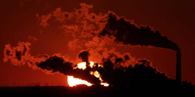 FILE- In this March 8, 2014, file photo steam from the Jeffrey Energy Center coal-fired power plant is silhouetted against the setting sun near St. Marys, Kan. A groundbreaking agreement struck Wednesday, Nov. 12, 2014, by the United States and China puts the world's two worst polluters on a faster track to curbing the heat-trapping gases blamed for global warming. (AP Photo/Charlie Riedel, File)