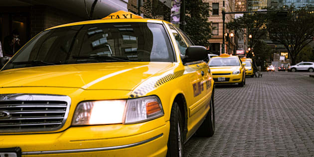 """This photo is <a href=""""https://crated.com/art/97559/yellow-cab-by-daveography"""" rel=""""nofollow"""">available for purchase as a print</a>!  This shot ended up being more interesting than I imagined.  After taking it, the cabbie behind the wheel (whom I didn't even notice was in the cab when I took the shot) rolls down his window and starts questioning me about taking his photo.  I explained that he wasn't even visible in the shot, and showed him the photo on my camera's display to prove it.  He started asking me what I was taking photos for, if I had a business card, etc.  I handed him my card and told him about the Flickr Friday project, that this week's theme was """"Taxi"""", and that I don't make any money off my photos.  He seemed to let it go, although was confused as to why I didn't have a phone number on my card, just a website.  I walked a bit further and asked the gentlemen standing outside their cabs if I could take their photo.  Two of them seemed ok with the idea (a third walked out of the frame), but then after I took the shot, they asked if it would go up on the Internet, and were less ok with the idea when I said yes.  At their request I deleted the photo while talking with them, and moved on."""