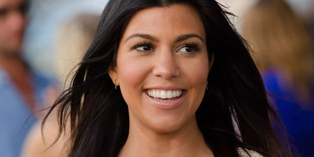 "Kourtney Kardashian attends the ""Party Under The Stars"" benefit hosted by Women's Health and Feed at the Bridgehampton Tennis and Surf Club on Saturday, Aug. 9, 2014 in New York. (Photo by Scott Roth/Invision/AP)"