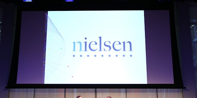 NEW YORK, NY - SEPTEMBER 30:  Senior Correspondent at CBS News, Anthony Mason (L) and CEO at Nielsen, Mitch Barns speak onstage at The Future of Measurement panel September 30, 2014 in New York City.  (Photo by Monica Schipper/Getty Images for AWXI)