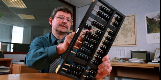 Leo de Bever, senior vp research and economics, for the Ontario Teachers Pension Plan Board with his abacus in his office. (Photo by David Cooper/Toronto Star via Getty Images)