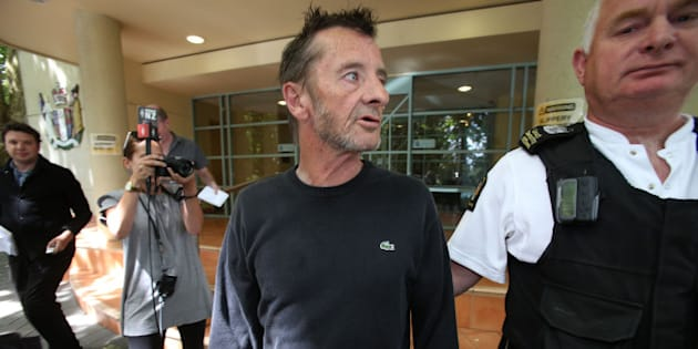 TAURANGA, NEW ZEALAND - DECEMBER 04:  AC/DC drummer Phil Rudd leaves Tauranga District Court after being arrested in relation to breach of bail conditions on December 4, 2014 in Tauranga, New Zealand.  Rudd is due back in court on February 10 for a case review hearing for charges of threatening to kill, and possession of cannabis and methamphetamine.  (Photo by Joel Ford/Getty Images)