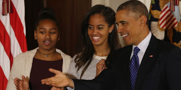 WASHINGTON, DC - NOVEMBER 26:  U.S. President Barack Obama (R) speaks as his daughters Sasha (L) and Malia (R) look on after pardoning 'Cheese' and his alternate Mac both, 20-week old 48-pound Turkeys, during a ceremony at  the White House November 26, 2014 in Washington, DC. The Presidential pardon of a turkey has been a long time Thanksgiving tradition that dates back to the Harry Truman administration.(Photo by Mark Wilson/Getty Images)