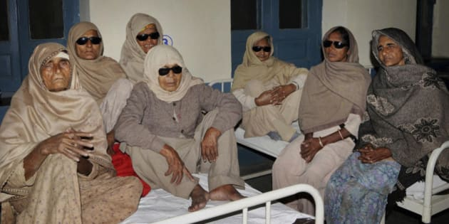 Indian elderly women who went blind following cataract surgeries performed at a free medical camp run by a charity sit together as they receive treatment at a hospital in Amritsar, India, Friday, Dec. 5, 2014. Authorities ordered an investigation Friday after at least 11 poor and elderly people went blind following the surgeries performed Nov. 4 in northern India. Some of the patients reported this week that they'd lost their eyesight or were suffering infections, Ravi Bhagat, a top official in Amritsar city. (AP Photo/Press Trust of India) INDIA OUT