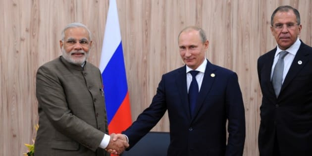 In this photo taken Tuesday, July 15, 2014, Russian President Vladimir Putin, centre, and Indian Prime Minister Narendra Modi, left, shake hands during their meeting attended, by Russian Foreign Minister Sergey Lavrov, right, at the sidelines of the BRICS 2014 summit in Fortaleza, Brazil. The leaders of the BRICS nations are meeting in Brazil for a summit where they are expected to officially create a bailout and development fund worth $100 billion. (AP Photo/RIA-Novosti, Mikhail Klimentyev, Presidential Press Service)