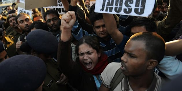 Indian residents hold placards and chant slogans as they take part in a protest against the alleged rape of a passenger by a driver working for the Uber taxi company in New Delhi on December 7, 2014. An Uber taxi driver allegedly raped a 25-year-old passenger in the Indian capital before threatening to kill her, police said December 7, in a blow to the company's safety-conscious image. AFP PHOTO/STR        (Photo credit should read STRDEL/AFP/Getty Images)