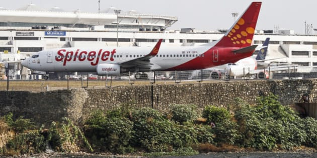 A SpiceJet Ltd. aircraft stands on the tarmac at Chhatrapati Shivaji International Airport in Mumbai, India, on Thursday, May 23, 2013. SpiceJet, India's third largest Indian airline by domestic market share, is scheduled to release their fourth-quarter earnings on May 24. Photographer: Dhiraj Singh/Bloomberg via Getty Images