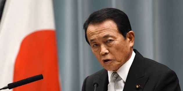 Japanese Finance and Deputy Prime Minister Taro Aso speaks during a press conference at the prime minister's official residence in Tokyo on September 3, 2014. Japanese Prime Minister Shinzo Abe named five female cabinet ministers on September 3, leading by example in a country which economists say must make better use of its highly-educated but underemployed women.       AFP PHOTO / TOSHIFUMI KITAMURA        (Photo credit should read TOSHIFUMI KITAMURA/AFP/Getty Images)