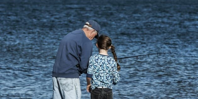 CAPE COD, MASSACHUSETTS, UNITED STATES - 2011/10/16: Man teaching his granddaughter to fish. (Photo by John Greim/LightRocket via Getty Images)