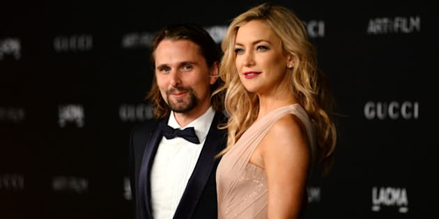 Matthew Bellamy, left, and Kate Hudson arrive at the LACMA Art + Film Gala at LACMA on Saturday, Nov. 1, 2014, in Los Angeles. (Photo by Jordan Strauss/Invision/AP)