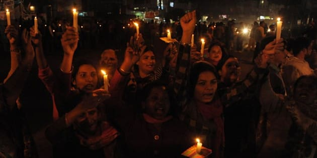 Indian Christian devotees hold candles and chant slogans during a demonstration against a suspected attack on a church in Amritsar on December 2, 2014. Police said December 2 they were investigating a blaze that devastated a church in the Indian capital New Delhi, as hundreds of Christians took to the streets to protest what they said was a deliberate attack. A church spokesman said there was a strong smell of kerosene after the fire on the morning December 1 at Saint Sebastian's, one of Delhi's biggest churches. AFP PHOTO/NARINDER NANU        (Photo credit should read NARINDER NANU/AFP/Getty Images)