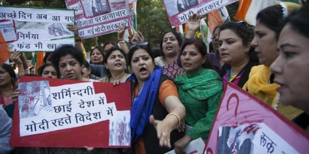 India's opposition Congress party's women activists shout slogans during a protest after a woman was allegedly raped by a taxi driver in New Delhi, India, Monday, Dec. 8, 2014. The Indian capital on Monday banned taxi-booking service Uber after a woman accused one of its drivers of raping her.(AP Photo/Tsering Topgyal)