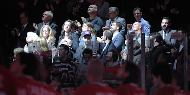 MONTREAL, QC - DECEMBER 9: Family members of the late Montreal Canadiens player Jean Beliveau during a ceremony prior to the during the NHL game between the Montreal Canadiens and the Vancouver Canucks at the Bell Centre on December 9, 2014 in Montreal, Quebec, Canada.   (Photo by Richard Wolowicz/Getty Images)
