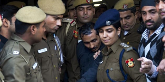 32-year-old Shiv Kumar Yadav, center, a driver from the international taxi-booking service Uber, is surrounded by police as he is brought out after being produced in a court in New Delhi, India, Monday, Dec. 8, 2014. The court ordered Yadav be held for three days for police questioning over allegations that he raped a finance company employee after being hired to ferry her home from a dinner engagement on Friday night. (AP Photo/Saurabh Das)
